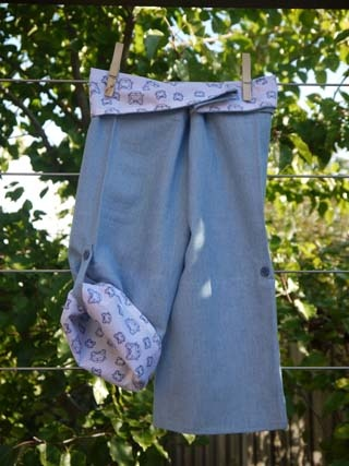 SALE $19.98 - Boys Wrap Pant (Peace, Love & Mung Beans!) 100% cotton UPF 20.  These are our take on the Thai fishing pant. They are lightweight and super comfy. These pants are fastened with adjustable velcro, so they're easy to do up, even for those still in nappies or toilet training. The bottom of the legs can be rolled up and buttoned so they can also be worn as a ¾ pant. They are 100% Australian made and designed with sun protection in mind.  www.shadydays.com.au