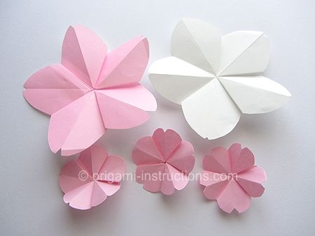 Origami cherry blossoms for my cherry blossom themed wedding! DIY and cheaper than buying!