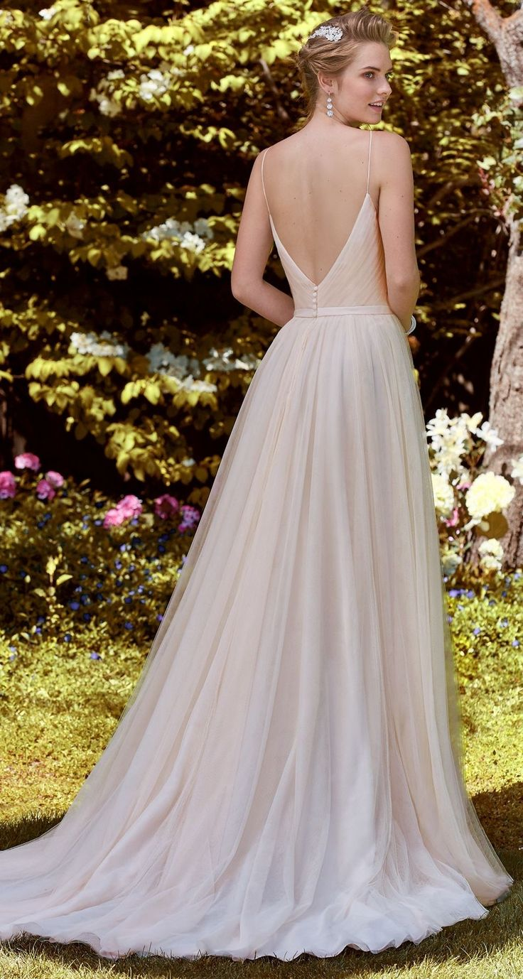 Rebecca Ingram - MAXINE, This A-line gown features layers of tulle completing the asymmetrically ruched bodice, V-neckline, and V-back.