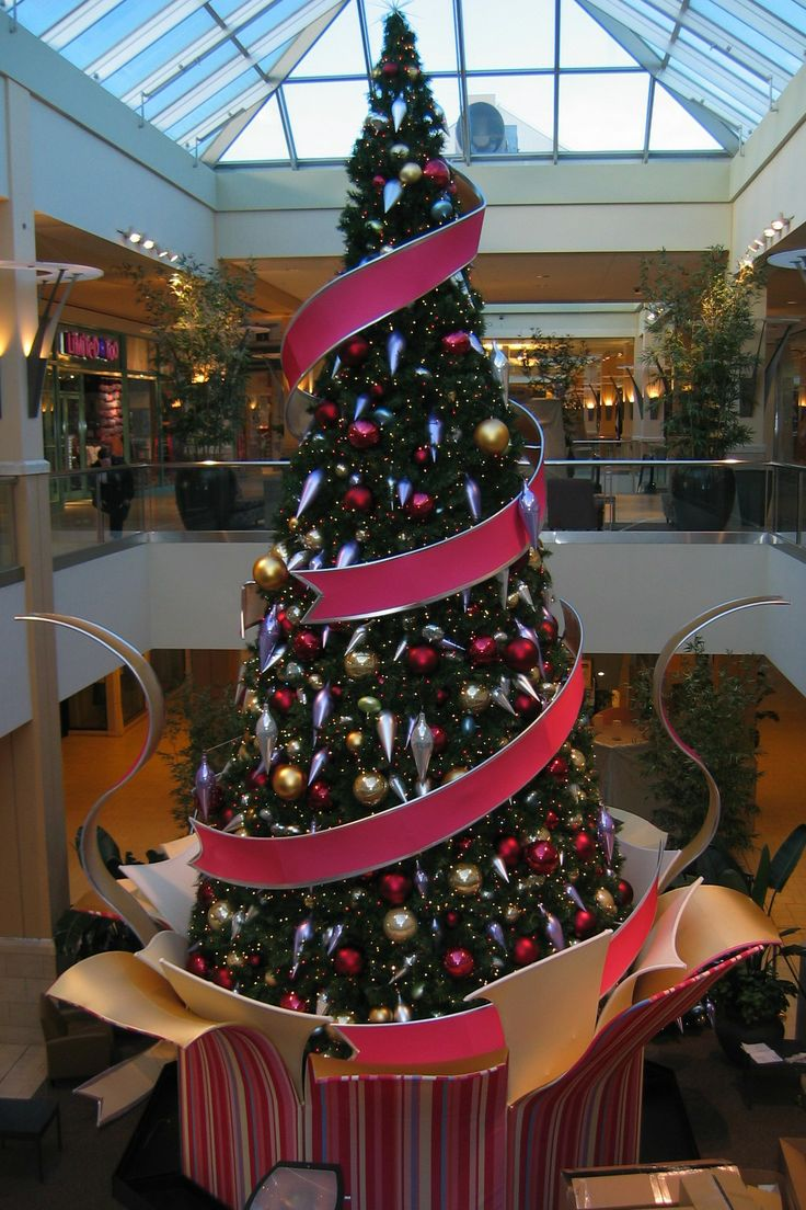 This Christmas tree in this shopping mall is created with tension fabric!  Both the gift box and fabric utilize fabric which has been shaped to fit around the tree.