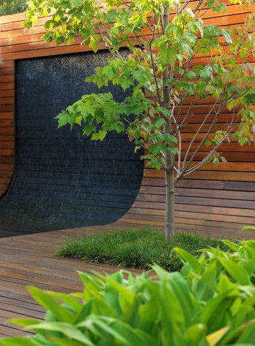 Round rooms aren't just for the indoors. Another great Aussie garden. Curved wall doubles up as a recliner