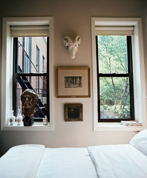 A vintage bust and a white ram's head in a neutral bedroom. http://www.lonny.com/photos/Faux+Animal+Head