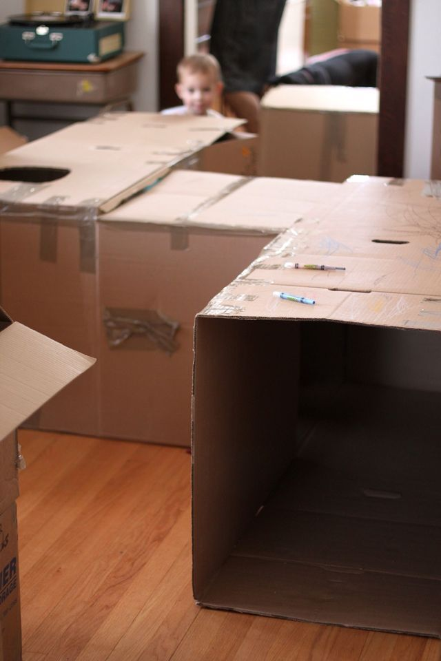 best reason ever to move - building an awesome room filling fort with the unpacked boxes... include sunroofs, working windows, towers, etc. Every kids dream for snack time, nap time, and it gives you freedom to unpack more boxes