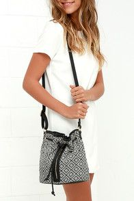 "Lulus Exclusive! The journey ahead can be a stylish one with the Road to Riches Ivory and Black Print Bucket Bag at your side! A lovely woven black and ivory tiled print makes its way across a flat-bottom bucket bag with a vertical zipper compartment, and classic drawstring top. Roomy, fabric lined interior boasts three wall compartments to keep your goodies organized! Carry by the 46"""" black vegan leather strap. #CuteDresses #TrendyTops, #FashionShoes #JuniorsClothing"