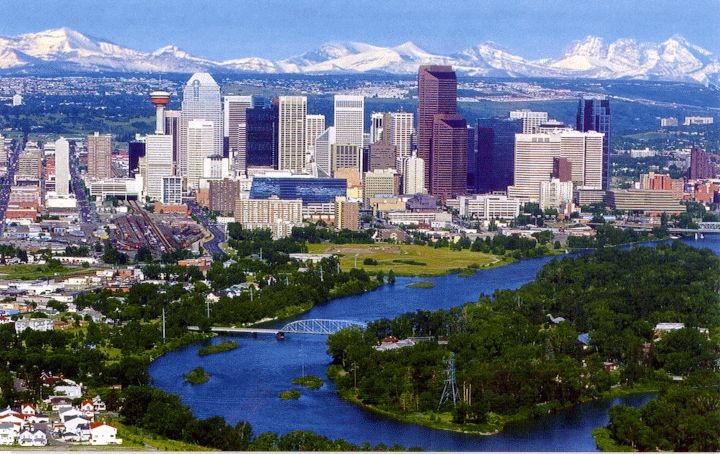 Beautiful view of Calgary. Mountains, City, River.