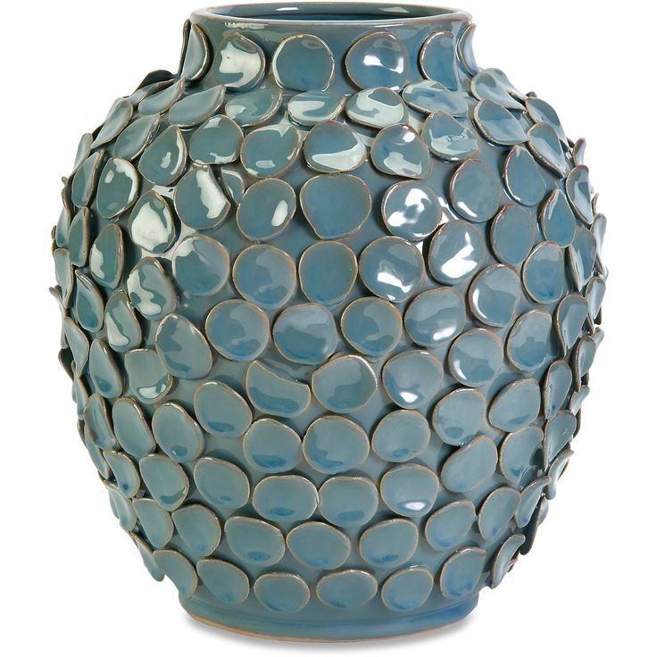Inspired by the tentacles of an octopus, the short, round Agean vase features hand laid ceramic texture with a subtle blue finish.