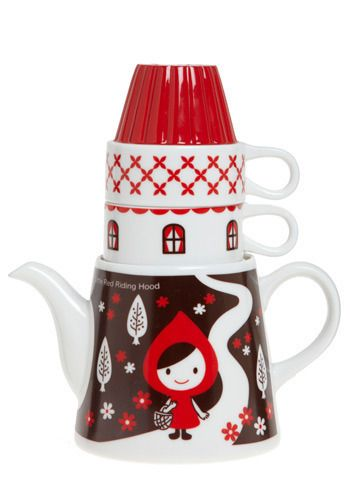 Little Red gleefully greets you as you steep another steaming sip of your favorite tea... with a wily wolf serving as the 'lift' on the lid of the teapot...