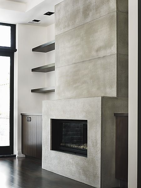 PIN 11: In this room the concrete is a feature of the room as it only covers the fireplace, it is in a room with quite dark tones but feels very contemporary