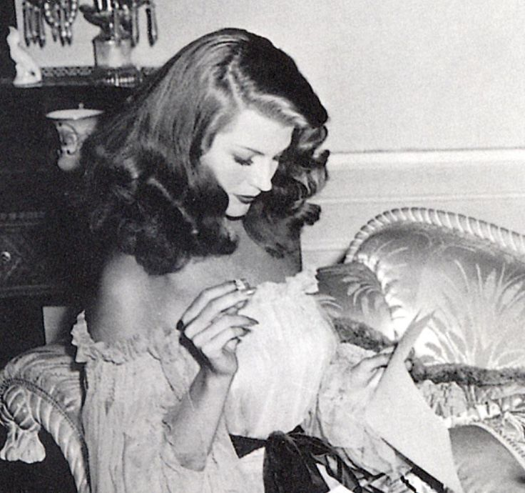 "Rita between scenes on ""Gilda"" (1946) - checking the script."