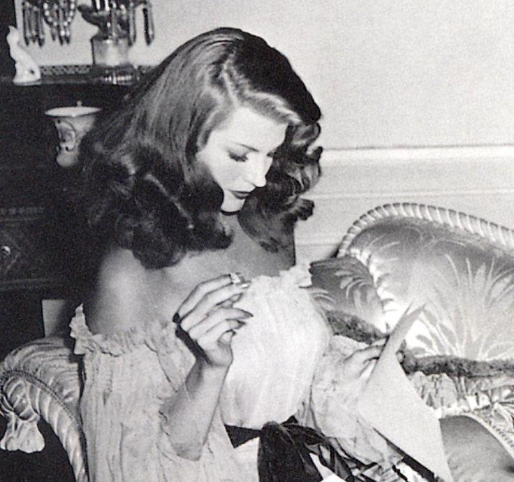 "Rita between scenes on ""Gilda"" - checking the script."