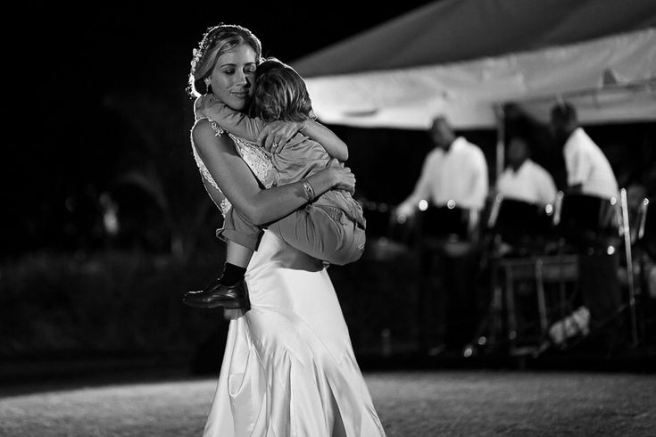 My wedding: bride and son dancing at outdoor reception  @Four Seasons Bridal @Four Seasons Resort Nevis, West Indies