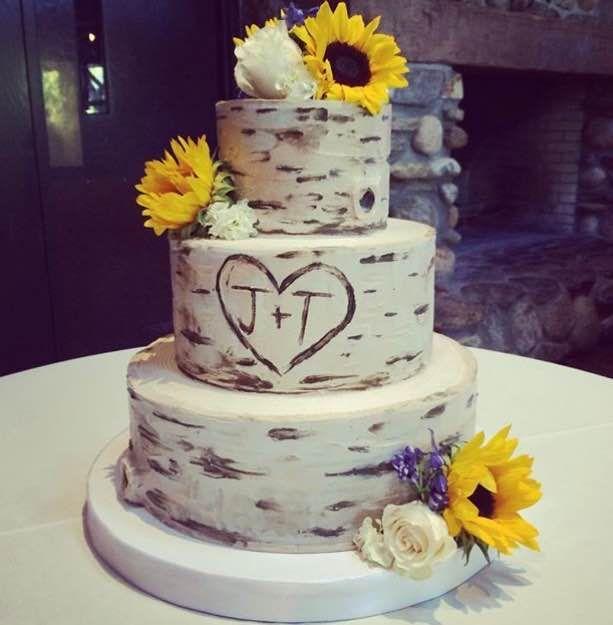 Buttercream Birch wood wedding cake with fresh sunflowers