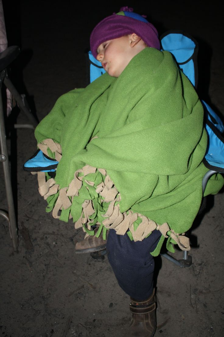 Still one of my favourites from a number of years ago. He got his beanie and blanket out of the campertrailer and fell asleep in front of the fire. Love it.