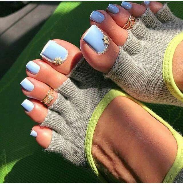Pretty baby blue nail polish with white tips and jewel accents | toe nail art design ideas for summer