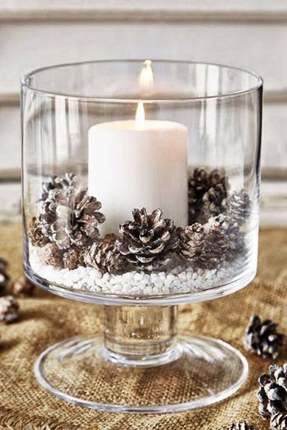 Simple faux snow with dusted acorns + candle - paint the tips of the acorns silver or gold for an extra touch!