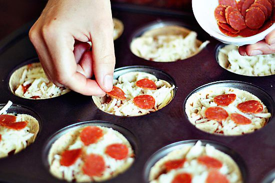 mini deep-dish pizzas made in a muffin tin. only 66 calories a piece! would make a great well-rounded snack