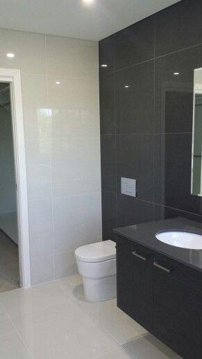Pale Grey and Regal Black polished porcelain available at toptiles.com.au