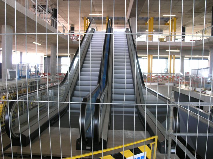 Beck & Pollitzer operatives transport and safely install Heathrow T-5 escalators.