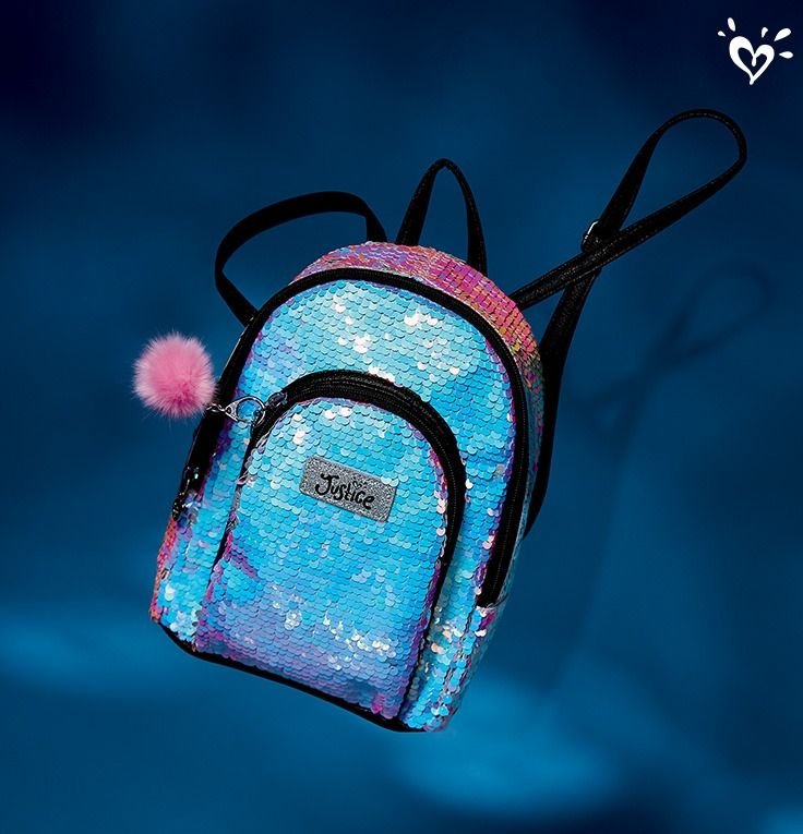 All the cute she can carry. Super cute mini backpack with all-over sparkle.