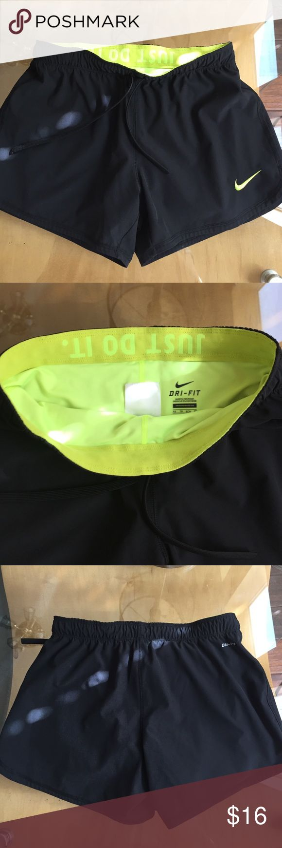 Nike Dri Fit Shorts Nike Dri Fit Shorts. Black with yellow bloomers . Drawstring. Had small hole as indicated in pic inside the seam of yellow shorts. Soft and comfortable. Otherwise in good condition. Nike Shorts