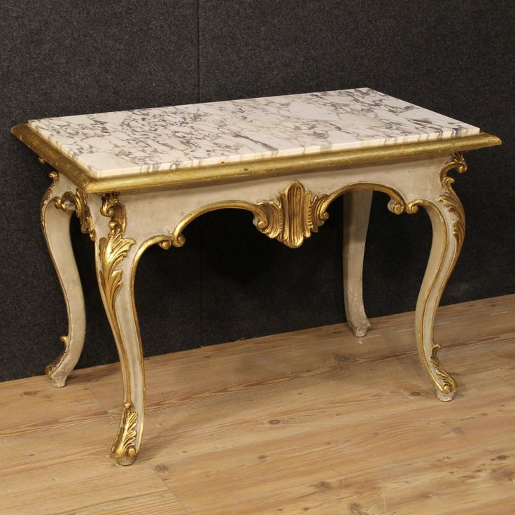 900€ Italian coffee table in lacquered and gilded wood. Visit our website www.parino.it #antiques #antiquariato #furniture #antiquities #antiquario #coffeetable #marble #table #tavolo #golden #gold #decorative #interiordesign #homedecoration #antiqueshop #antiquestore