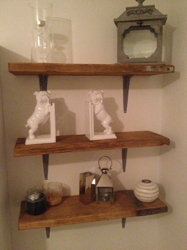 Living room shelves made from reclaimed scaffolding boards