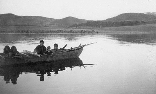 Yahgans in dugout canoe, 1898.