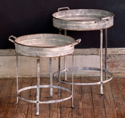 The Perfect Pair - Farmhouse Tray Tables - These two table are pure perfection. No doubt about it. Aged finish on metal with raised tray edges and darling details on the legs and feet.The handles make it even more farmhouse perfect!A rustic feel, a perfect design and a charming look.We could go on and on about these two. But don't worry, we won't!