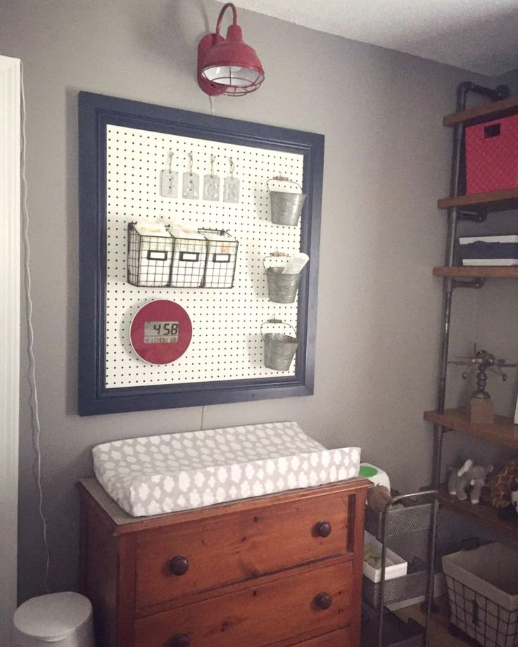 Great changing table organization by using a pegboard to display and hold diaper supplies!