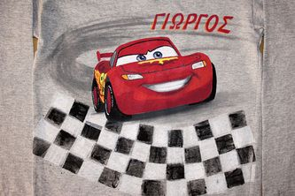 """Hand painted boy's t shirt, featuring Lightning McQueen from Disney's movie """"Cars"""". A boy's name (George) is written in Greek. The colors are non-toxic, water based, permanent fabric colors."""
