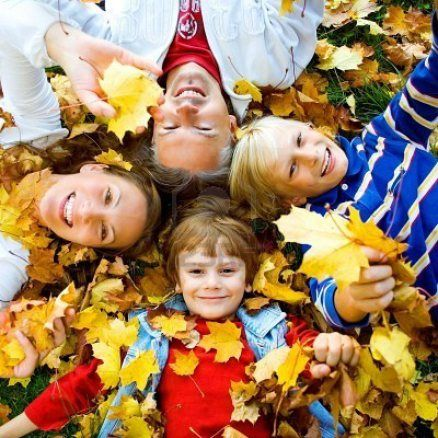 Fall family picture in autumn leaves