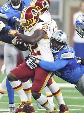 Redskins vs. Lions;   -   October 23, 2016  -  20-17, Lions  -    Detroit Lions defensive lineman Khyri Thornton tackles Washington Redskins RB Robert Kelly during the first half Sunday, Oct. 23, 2016 at Ford Field in Detroit.  Kirthmon F. Dozier, DFP