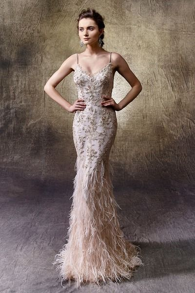 Glam wedding dress idea - mermaid gown with flowy and delicate ostrich feathers on soft tulle skirt - classic V-neckline and thin beaded spaghetti straps. Style Leonie by @enzoani.