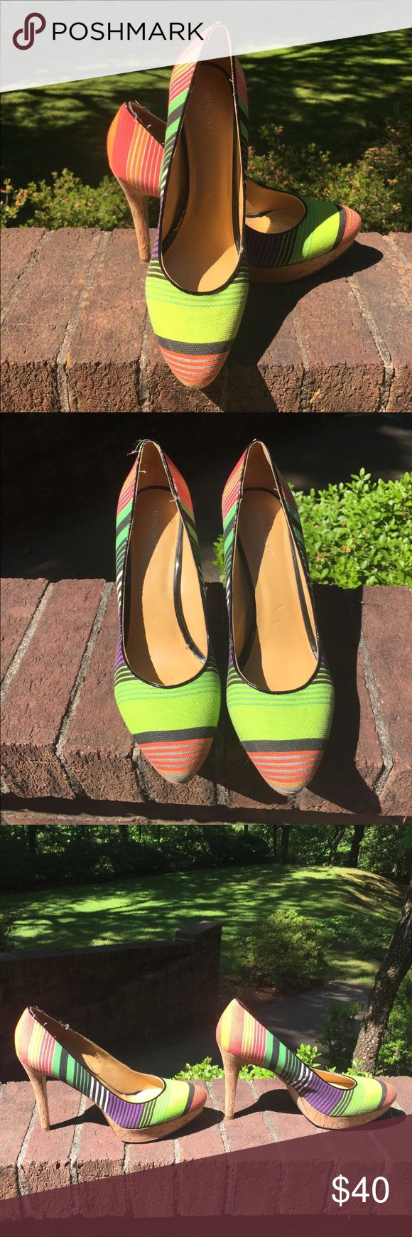 Funky & fun neon stripe pumps by Nine West! Gorgeous neon stripe Nine West pumps. Cork on the sole, fabric-type stripes on the upper. Almond toe pump- great as a pop of color with a little black dress or paired with skinny jeans or leggings! Wore them a few times but they are a half size too big for me. Nine West Shoes Heels