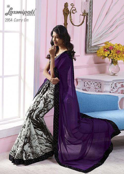 his purple chiffon pallu in off white satin silk material saree with black color border.