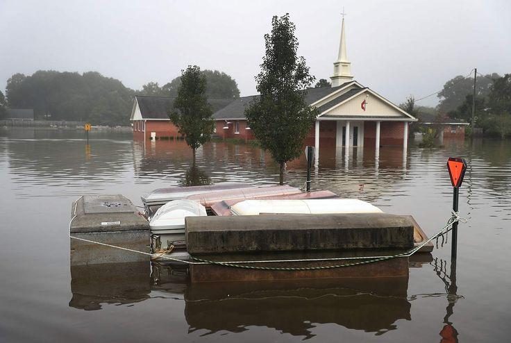 Caskets floating in floodwaters near a cemetery in Gonzales, La.