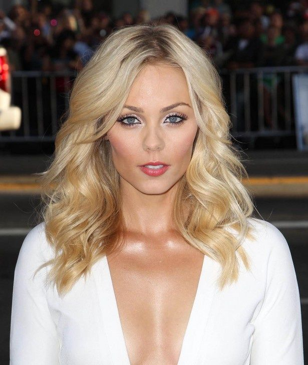 Laura Vandervoort's blonde medium length hair is a perfect cute for anyone trading in the longer locks for a medium cut.