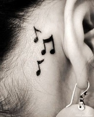 Music notes tattoo....Music is my life besides all the family. Supporters and the fan they mean every part of me :) <3