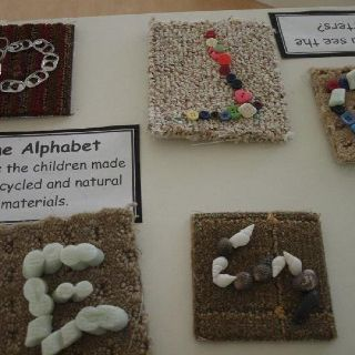 "Alphabet, but I see numeracy with the ""7"" too. These are Reggio inspired ""loose parts"" on carpet samples, and photographed for ""documentation""."