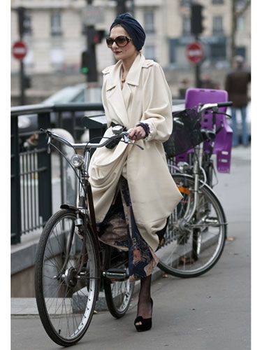 Only in Paris does a woman look this good on her bike.