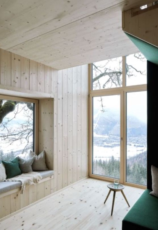 """This cabin living room with panoramic view is from our feature """"Go with the Snow"""""""