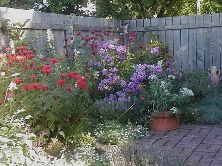 Terrace U0026 Gardens: Amazing Flower Garden Design For Small Backyards Natural  Colorful Flowers Brown Fence, Small Backyard Design, Garden Design
