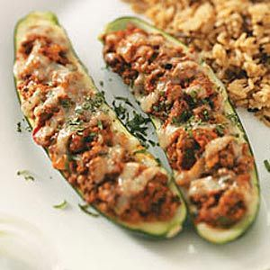 Southwest Zucchini Boats. Doubt you need bread crumbs. Sub lean ground turkey to make low cal version.
