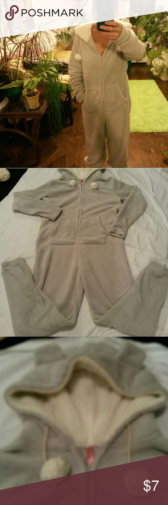 Super fluffy pj onesie Soft, fluffy and warm. Zips up front. Hooded with cute ears, drawstring for hood has pom pom balls on ends. Pockets. Light marks on right chest area. (Looks like something ran when washed-see last pic) Rue 21 Intimates & Sleepwear Pajamas