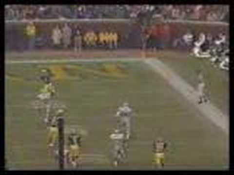 "Ohio State Buckeyes vs Michigan Wolverines from 1991: Desmond Howard's Punt return for a touchdown with the Heisman pose with the famous quote by Keith Jackson, ""Hello Heisman"""