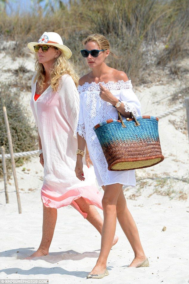 Olivia Palermo nails holiday chic as she hits the beach with Valentino #dailymail