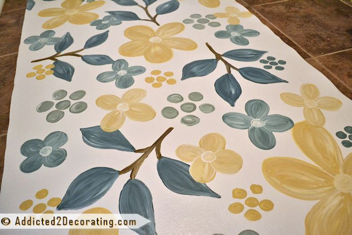 Hand painted floor cloth wth flowers and leaves design