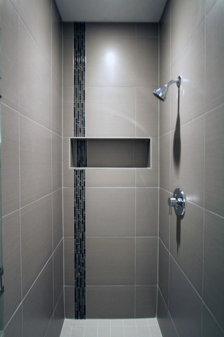 Bathroom tile vertical stripe - The Porcelain Tile Of This Sleek Shower Surrounds A Glass Accent Tile Stripe And Built