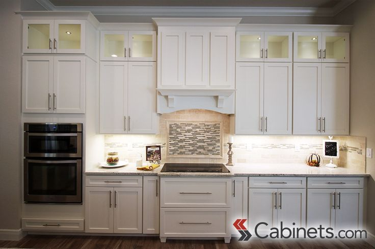 This beautiful white kitchen features colonial ii maple for Colonial kitchen cabinet ideas