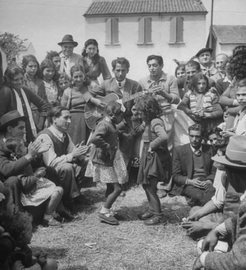 French gypsies playing music and dancing. Photograph by Yale Joel. France, June 1948